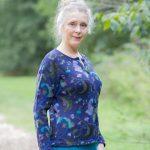 Araña alpaca wol damesvest blauw gebloemd Peru knitwear